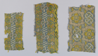 Three fragments of embroidered carpet in an allover diagonal lattice field with knotted cord borders.