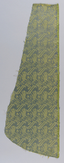 Diagonal bands and lions rampant in yellow and blue. Selvedge on one side. Piece is cut as if for a chasuble.
