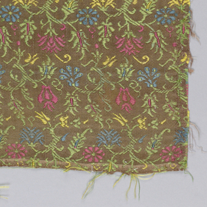 Brown panel with multi-colored small scale designs and flowers.