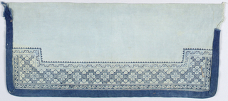 "Sleeve band of light blue cotton, embroidered in wool at one side in small-scale geometric pattern, entwined by a repeated ""S"" pattern. Edged with dark blue cotton on three sides."