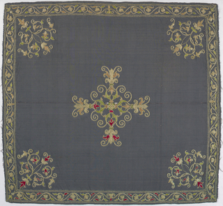 Faded purple ribbed silk ground embroidered in colored silk and metallic thread. Central design shows a cruciform composed of conventionalized flowerheads in profile and S-forms of foliage. Cover design of symmetrical delicately curving vine and flower. Narrow border of similar small scale design. Red, pale green and peach-colored silks.