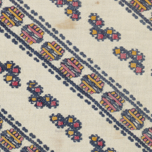 Pair of natural plain weave linen sleeves embroidered with cotton, showing pattern of blue diagonal lines composed of dots and clusters of yellow, pink and blue.
