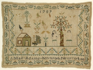 The field has scattered motifs including house, a peacock, urns of flowers, birds, and Adam and Eve with the Tree of Knowledge. Surrounded on three sides with a geometric border and on all four with a strawberry vine border. With the date 1789 at the top and the inscription Abigail Adams her work New York at the bottom.