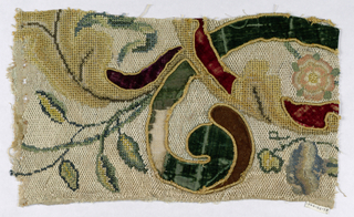 Design of horn of plenty, swinging branches and flowers worked in Florentine stitch and velvet applique.