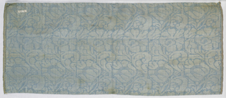 Selvage to selvage width with design of flowers facing in alternate directions in blue and silver.