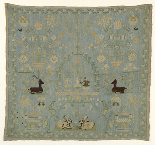 Figures of a man and woman in an arbor with the initials K.S. and the date 1753, and motifs symmetrically arranged, including a pair of confronted rabbits at the bottom and crouching stags on each side. On a blue cross-stitched background.