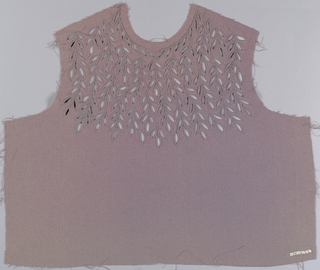 Gray dress front with leaf-shaped cutouts scattered around the yoke. Cutouts are embroidered with matching thread in an eyelet style.