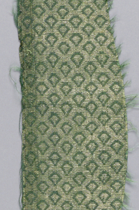 Design of triangular shapes in a diamond grid in gold on green.