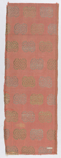 Coral fabric with geometric motifs alternately gold and silver.
