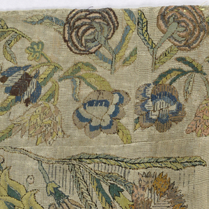 Panel of linen embroidered in silk and metallic thread showing a central escutcheon framed by a laurel wreath. Above the escutcheon are the raised initials PPS and ACU in silver thread over padding. Smaller wreath in the lower left hand corner embroidered in silver thread with the following motto: La Beauté Vertu L'Honneur Flambequx D'Un Grand Coeur. At the lower right corner: Coeur Et Courage Font L'Ouvrage. Outer border pattern shows large floral sprays.