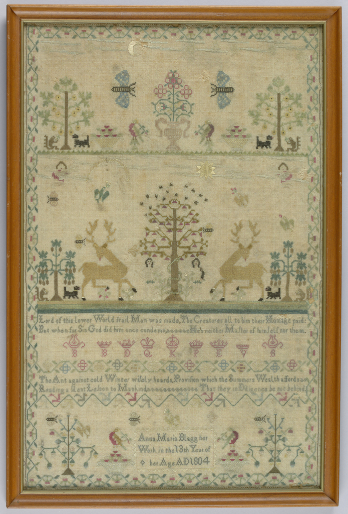 Finely worked in colored silks on bolting cloth.  Three sections with flower urn, insects and animals, Adam and Eve, verses, running vine border.