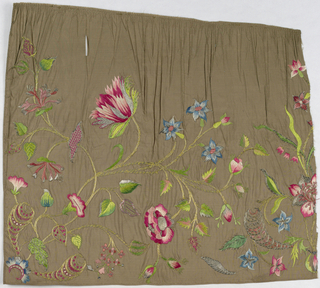Design of curving stems with several different kinds of flowers and leaves; worked in couching, French knots, laid and satin stitches.  Colors: pinks, blues, green, and much gold on brown ground.