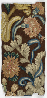 Heavy brown fabric with fragmentary serpentine floral design embroidered in polychrome wools yarns in split stitfch.