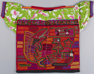 "Blouse with pink and white floral print on green cotton (?) - sleeves and yolk. Mola panel in front and back, same design, backed in black, red top layer; middle panel shows through in yellow, orange, blue, pink, green, etc. Large fish sitting on tail with barbed hook. Boat with four passengers - ""A,M 4,5"" and fisherman. Top right, two black figures playing ball."