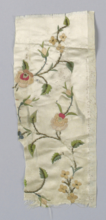 White satin ground with an incomplete design of small-scale roses in red, rose, pink, green, and tan silk with short pieces of gilt wire coils.