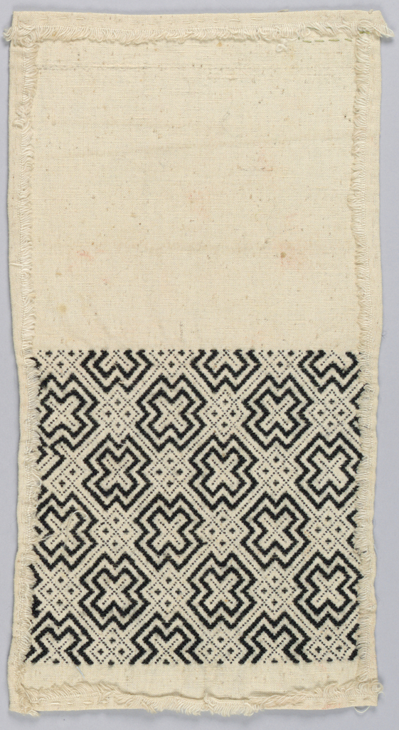 Undyed strip of cotton cloth to be made into a bag with embroidered decoration in black wool on one half. All-over pattern of diamond framework with filling of tipped crosses.