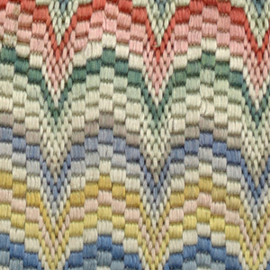 Cotton mesh solidly embroidered in multicolored silk. Scallop design in flame stitch.