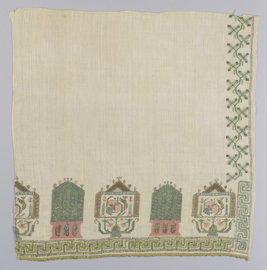 End crossed by two types of shrine forms (?) alternating in blue, green, and pink silk silver thread with touches of brown and cream. Fret border in cream and silver across the bottom and a short distance up the sides; Stylized floral border above this with much-rubbed silver braid across the end.