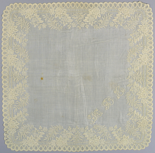 White linen handkerchief with wide border of embroidery. A diagonally placed spray of flowers alternates with leaf spray above a scalloped border with drawnwork ornament; initials M.B.C.