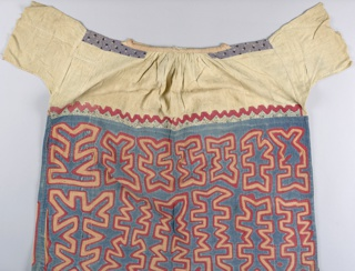 Woman's blouse with short sleeves. The top part is made of a figured white cotton and trimmed with bands of small-patterned printed cotton. Deep border of appliqué in red and blue-green on a ground of pinkish-orange. Pattern in two rows of highly stylized forms suggested a plant.