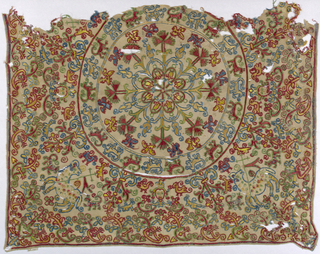 Fragment of linen square embroidered in tan, blue, red and green. Central star with radiating branches of carnations, rose buds and birds, procession of animals. In corners Agnus Dei and Sacred Heart.