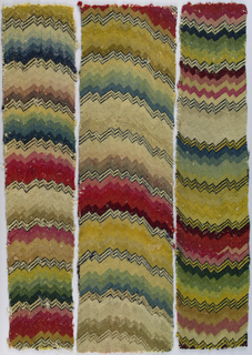 Three fragments of embroidered upholstery fabric in a multicolored zigzag pattern (flame stitch).