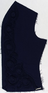 Side panel of a dress front in navy blue silk embroidered with navy blue rosettes and silk cord creating densely arranged floral forms.
