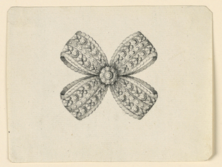 Jewelry design for a brooch. Design takes shape of a knot, the ribbons of which are patterned with blossoms and spheres, accented by a central rosette form, à jour.  The inside has three stripes, the central being a band, between two with alternating blossoms and disks. Beveled corners.