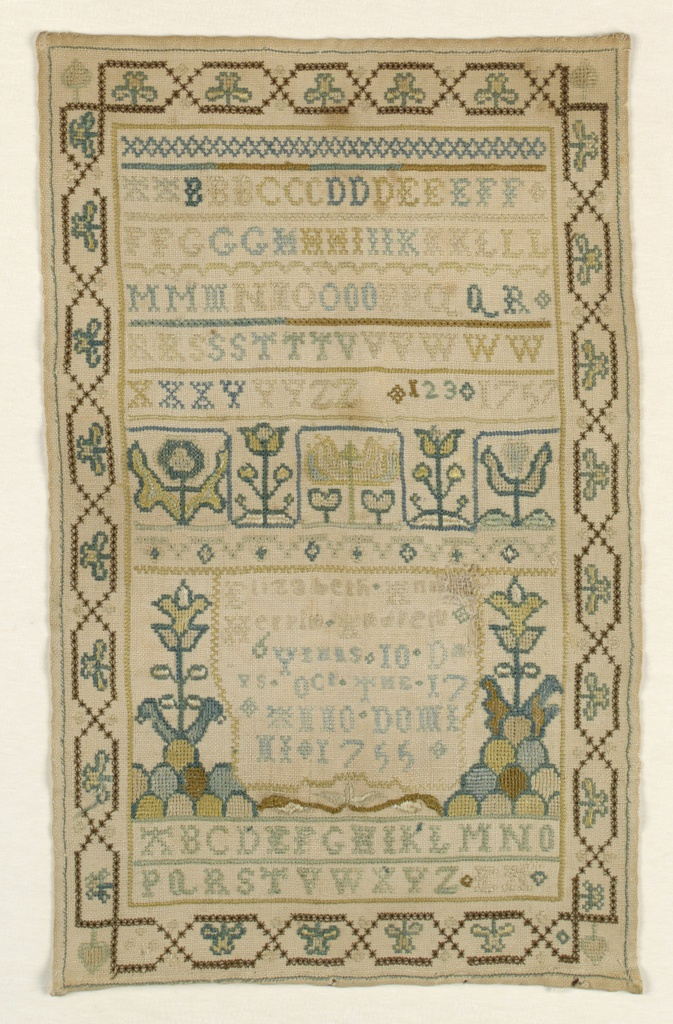 Alphabets, highly stylized floral elements, and an inscription embroidered in colored silks on a white linen ground. Surrounded by a chain link border with four-leaf clovers and spades in the corners.