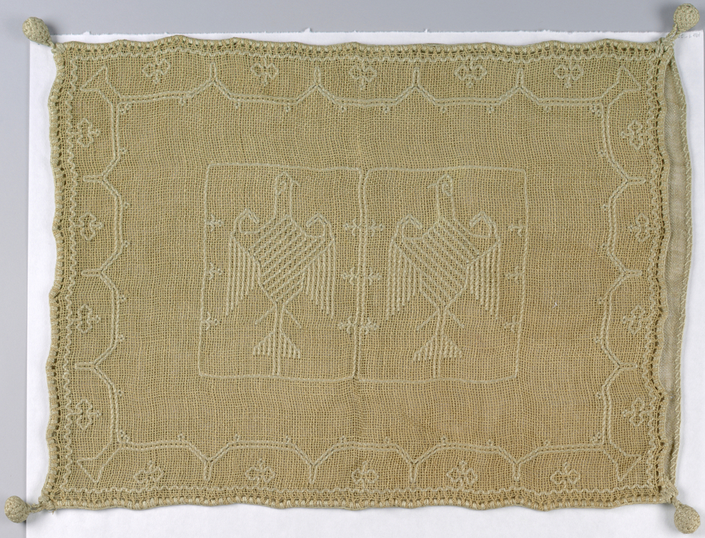Coarse, open weave linen, unbleached and embroidered in heavy white cotton; double eagle center; buttonhole edge. Pattern of eagles.
