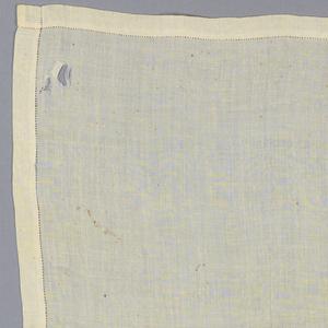 White linen handkerchief with diamond-shaped monogram. S.A.H.