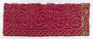 A red satin fragment with heart-shaped motifs, stylized flowers, and scrolls.