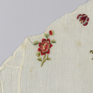 Pieced fragment of sheer white muslin embroidered in small scale scattered designn of garden flowers and butterflies, in polychrome wools. Satin, long and short, stem stitches.