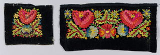 Pair of woven black velveteen cuffs embroidered with cotton in a dense symmetrical pattern of polychrome flowers and leaves.