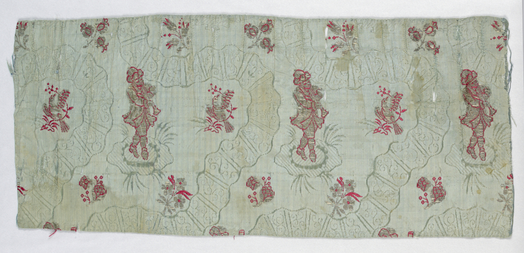 Blue taffeta with deeply curving serpentines in warp of the ground fabric. Between serpentines, in horizontal rows, figure of a man playing a clarinet, alternating with a bird on a slender branch. Alternate horizontal rows have sprays of flowers. Design brocaded in silver metal thread with outlines in red silk brocade.