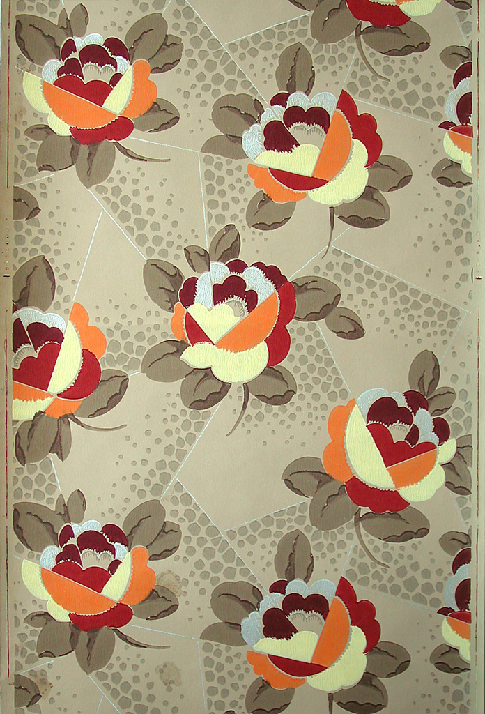 Stylized cubist-inspired flowers. Printed in yellow, orange, tan and metallic silver on tan ground.