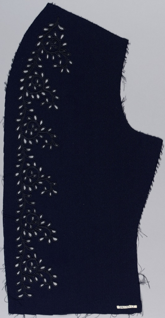 Side panel of a dress front in navy blue silk ornamented with leaf forms cutouts arranged in waving lines and scrolls. Worked in the technique of eyelet using silk cord.