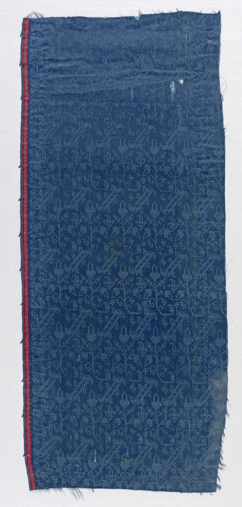 Diagonal bands with acorns in blue. One selvage present.