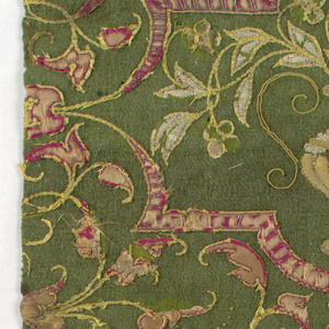 Section of horizontal border filled with arabesque foliage and stems enclosing urn and flowers; guard border with symmetrical stems, foliage, interlacery. Couched red and white satin outlined in heavy gold thread caught down in bunches; this also forms stems. Dark yellow-green wool ground.