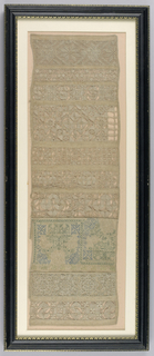Long sampler with bands of reticella work based on a grid of withdrawn elements; one embroidered band in running back stitch in blue and green (not completed).  The linen is doubled back on either side of the embroidered band.