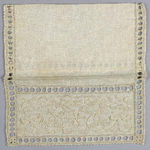 Small pouch with an embroidered flap in a design showing a symmetrical scroll in natural linen.