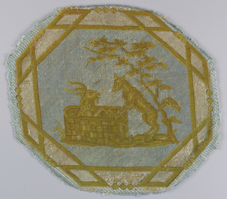"Octagonal medallion of upholstery fabric illustrating a fable by Aesop known as ""The Fox and the Goat."" The pattern is in white and shades of yellow on a light blue ground."
