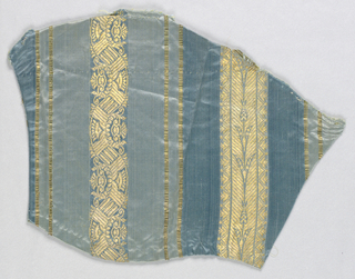 Fragment of a dress fabric with solid stripes in two tones of blue and stripes of brocaded metallic gold. Gold-patterned stripes have plant motifs and a chinoiserie pattern.