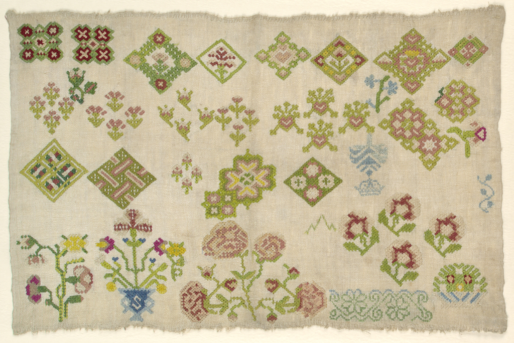 """""""Spot"""" sampler of assorted geometric and floral motifs."""