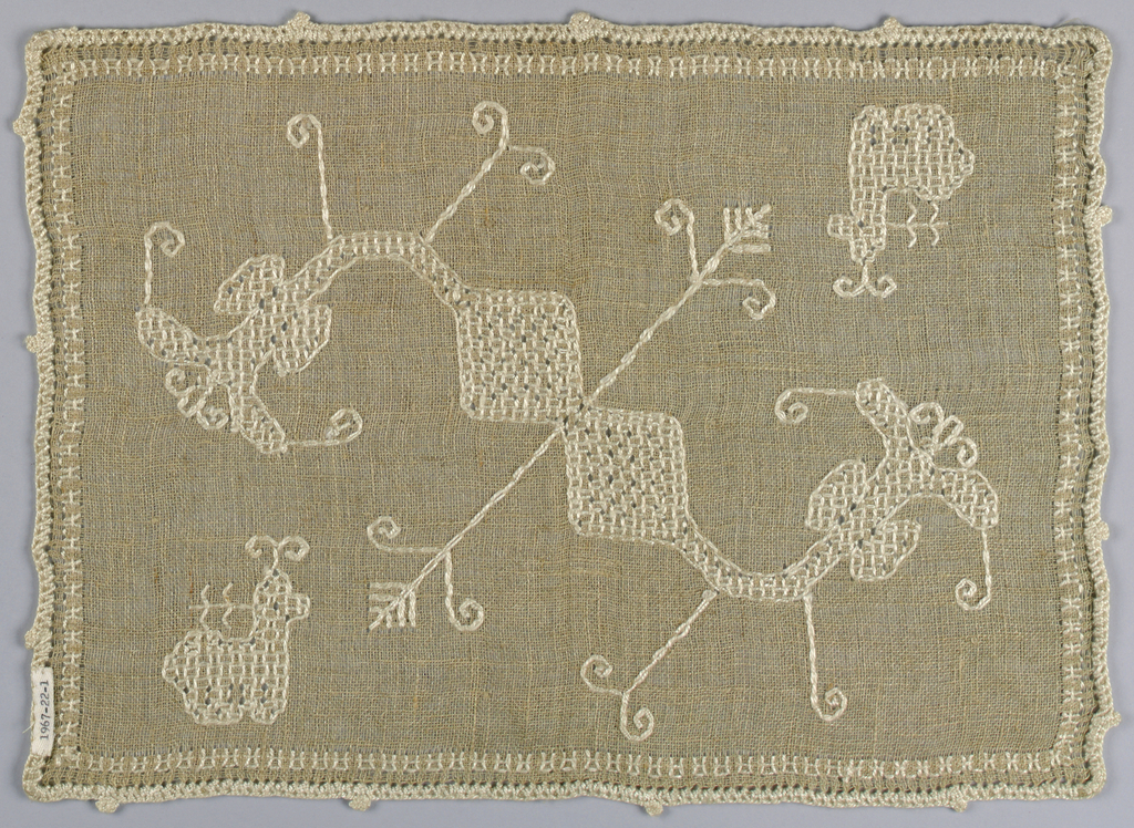 Small mat of natural color linen, embroidered in white cotton in cross stitch; broad stylized plant with animal in corner.