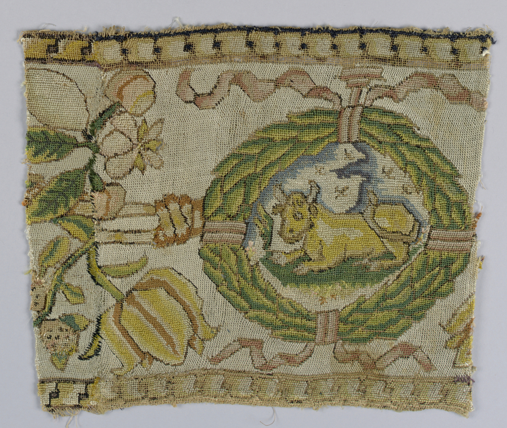 Border fragment with a cow in a wreath in multicolored silk.