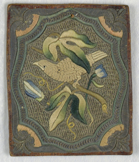 Design of a bird on a flowering branch, worked in silk, with background and frame in metal.