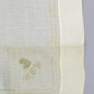 """White linen handkerchief with an embroidered border, an embroidered """"Pelican-in-her-Piety"""" and the initials W.C.P."""