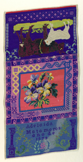 The sampler is divided into three sections. In the upper third, a brown cow with a white calf, upside down to the center panel. In the center, a floral bouquet in many colors on a red ground, surrounded by geometric borders in shades of violet. In the lower third, the inscription in embroidered in blue on a blue ground, with a pillar on either side.
