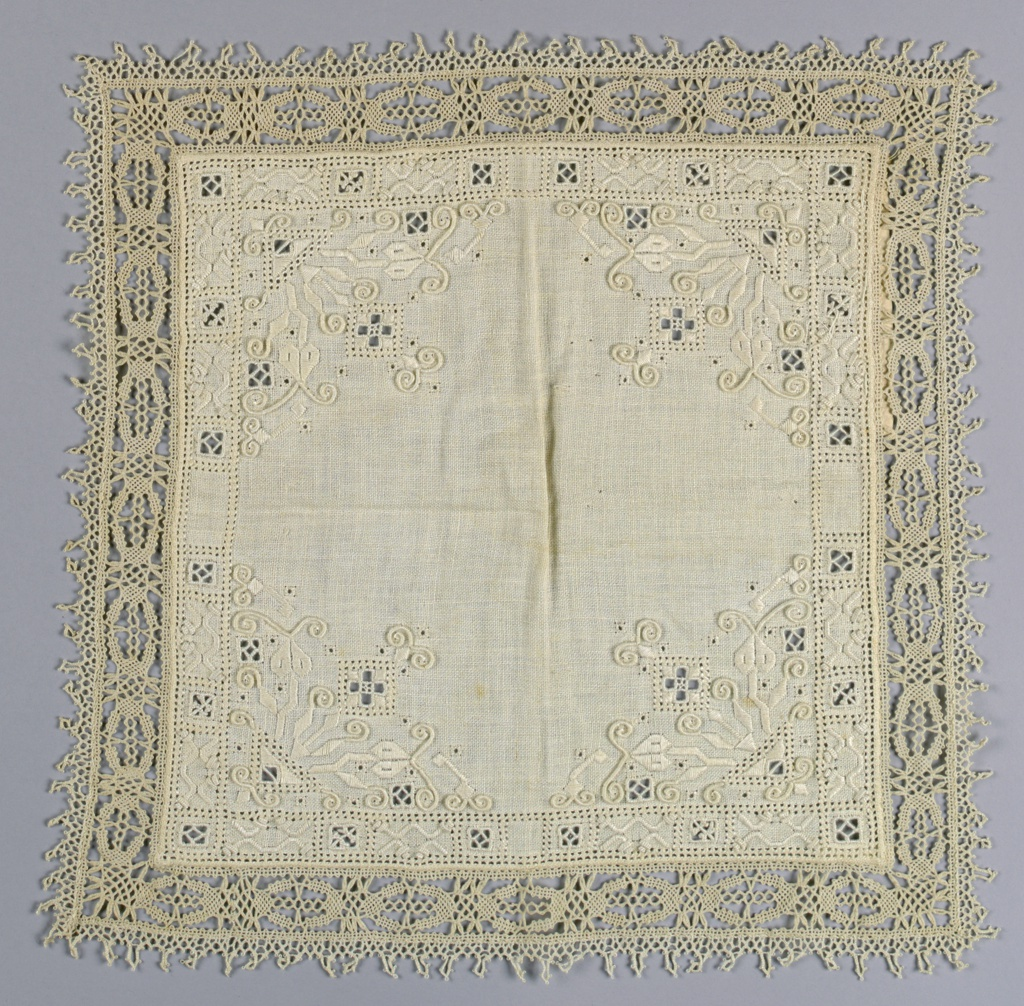 Small square with an embroidered floral motif in each corner.